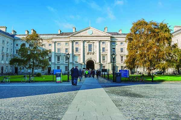 Dublin, Ireland - Oct 25, 2014: People at Trinity College yard in Dublin, Ireland on October 25, 2014